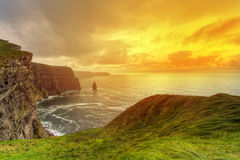 Sunny scenery of Cliffs of Moher. Idyllic sunset at Cliffs of Moher, Co. Clare, Ireland Stock Images