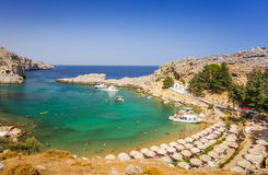 Sunny sea beach in Lindos Stock Photos
