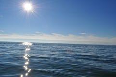 Sunny sea scene boat fishing Stock Photos