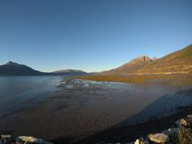 Sunny sea, shore and mountains in northern norway Stock Photo