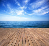 Sunny sea and wooden walkway Stock Photography