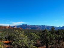 Sunny Sedona Day: Red Rocks and Blue Skies. A series of photos of a late December day in Sedona, Arizona. All photos feature the red rock formations unique to royalty free stock photography