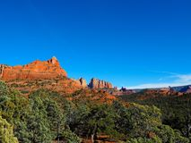 Sunny Sedona Day: Red Rocks and Blue Skies. A series of photos of a late December day in Sedona, Arizona. All photos feature the red rock formations unique to stock photos