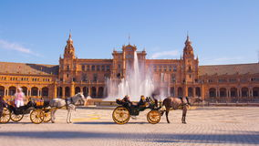 Sunny seville palace of spain fountain tourist horse ride 4k time lapse spain
