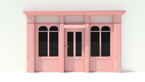 Sunny Shopfront with large windows White and pink store facade with awnings Stock Photos
