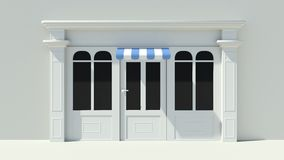 Sunny Shopfront with large windows White store facade with blue and white awnings Stock Photos