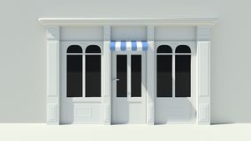 Sunny Shopfront with large windows White store facade with blue and white awnings Stock Image