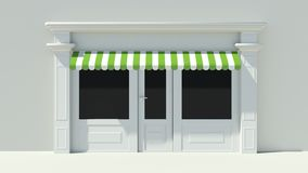 Sunny Shopfront with large windows White store facade with green and white awnings Royalty Free Stock Photo