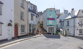Sunny shops and steps with people shoppingBrixham Torbay Devon E Royalty Free Stock Images