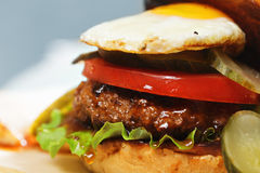 Sunny side up burger closeup Stock Images