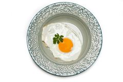 Sunny side up egg. In plate on white Stock Photography