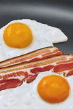 Bacon And Eggs Breakfast - Sunny Side Up Eggs Fried With Bacon Rashers In Teflon Frying Pan Detail. Sunny Side Up fried eggs with, Bacon rashers in Teflon frying Royalty Free Stock Photography