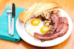 Sunny side up eggs with organic bacon Royalty Free Stock Images