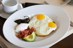 Sunny side up eggs on a plate Stock Photo