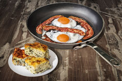 Sunny Side Up Fried Eggs In Old Frying Pan With Plateful Of Cheese And Spinach Pie Zeljanica Slices Set On Old Garden Table Stock Images