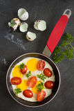 Sunny side up quail eggs fry with tomato and parsley, top view Stock Photos