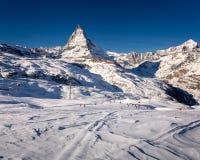 Sunny Ski Slope and Matterhorn Peak in Zermatt Royalty Free Stock Image