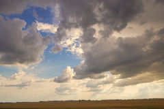 Sunny sky abstract background, beautiful cloudscape, on the heaven, view over white fluffy clouds, freedom concept Stock Photography