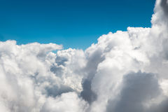 Sunny sky abstract background, beautiful cloudscape, on the heaven, view from the window of an airplane flying in the clouds. Stock Image