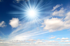 Sunny sky background. Clouds in the sky with the sun rays Stock Photography