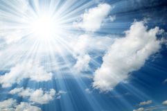Sunny sky background. Sky with clouds and sun rays Stock Photo