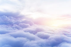 Sunny sky background. Sunny sky abstract background, beautiful cloudscape, on the heaven, view over white fluffy clouds, freedom concept stock image