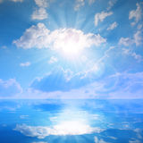 Sunny sky with clouds above a water level. Nature background Stock Photography