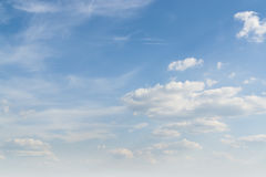 Sunny sky with clouds. Full frame sunny sky with some clouds Stock Photo
