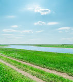 Sunny sky with clouds and green landscape with river Royalty Free Stock Photo