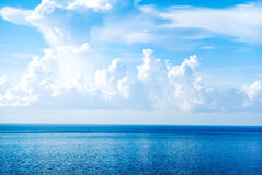 Sunny sky with fantastic white clouds and blue sea. Royalty Free Stock Photography