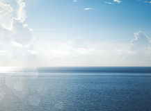 Sunny sky with fantastic white clouds and blue sea. Stock Photo
