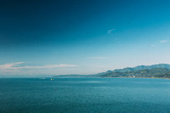 Sunny Sky Over Calm Water Of Sea Or Ocean. Natural Background Wi Stock Images