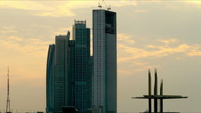 Sunny skyscrapers abu dhabi 4k time lapse Royalty Free Stock Image