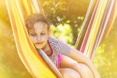 Sunny Sleeping i hängmatta Fotografering för Bildbyråer