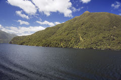Sunny slopes in Dusky Sound Stock Photo