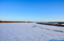 Ice-bound lake in winter day stock images