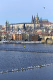 Sunny snowy Prague gothic Castle with Charles Bridge, Czech Republic Royalty Free Stock Photos