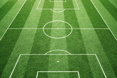 Sunny Soccer field background. Soccer play field ground lines on sunny grass pattern background. Goal side perspective used Stock Photo