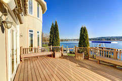 Sunny spacious walkout deck of luxurious waterfront home Royalty Free Stock Photography