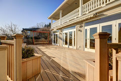 Sunny spacious walkout deck of luxurious waterfront home Stock Image