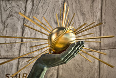 A Sunny Spirit. The Spirit of Detroit was commissioned in 1955. In its left hand, the large seated figure holds a gilt bronze sphere emanating rays to symbolize Royalty Free Stock Images