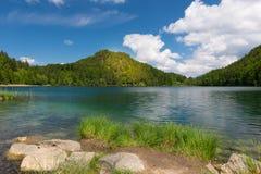 Sunny spot on mountain at lake alatsee Stock Image
