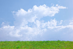 Sunny spring background with clouds on the blue sk Stock Photo