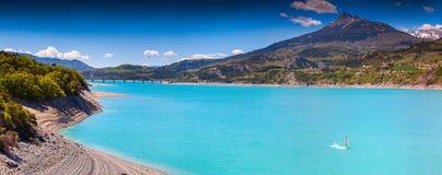 Sunny spring day at Lake Serre-Poncon. Royalty Free Stock Photos