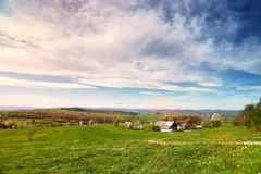 Sunny spring day in village and town on foothills Stock Photo