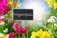 Sunny Spring Flower Meadow, Fruehjahrsputz Means Spring Cleaning. Sign With German Text Fruehjahrsputz Means Spring Cleaning. Sunny Spring Flower Meadow With Royalty Free Stock Photo