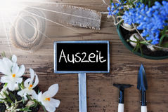Sunny Spring Flowers, Sign, Auszeit Means Downtime Stock Images