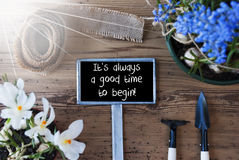 Sunny Spring Flowers, Sign, Quote Always Good Time To Begin. Sign With English Quote It Is Always A Good Time To Begin. Sunny Spring Flowers Like Grape Hyacinth royalty free stock photography