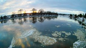 Spring landscape with moving ice floes. Sunny spring landscape with moving ice floes and clouds, 4k timelapse footage stock footage