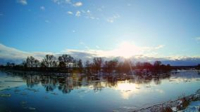 Spring landscape with moving ice floes. Sunny spring landscape with moving ice floes and clouds, 4k timelapse footage stock video footage